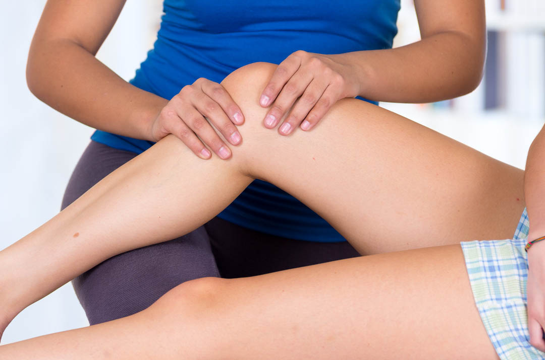 woman lying while getting a leg massage concept of physiotherapy